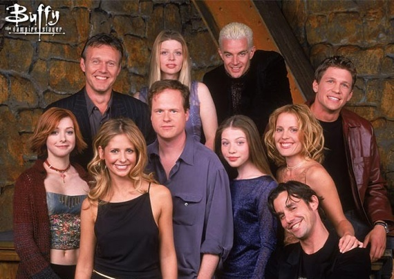 Joss Whedon surrounded by the Buffy cast